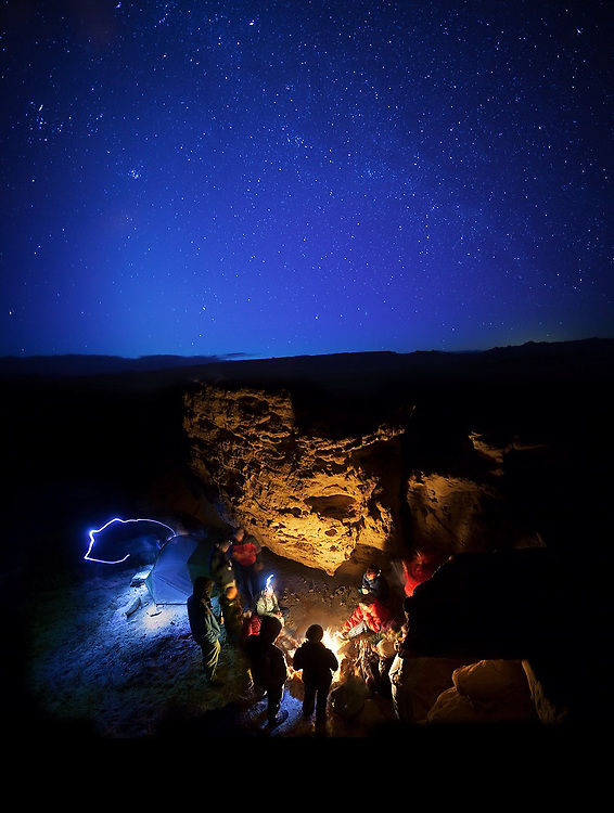 Students on a geology field trip with the University of Colorado enjoy a campfire at night at their camp on BLM land near Hanksville, Utah.