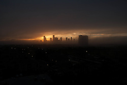 Silhouetted skyline of Houston, Texas at sunset.