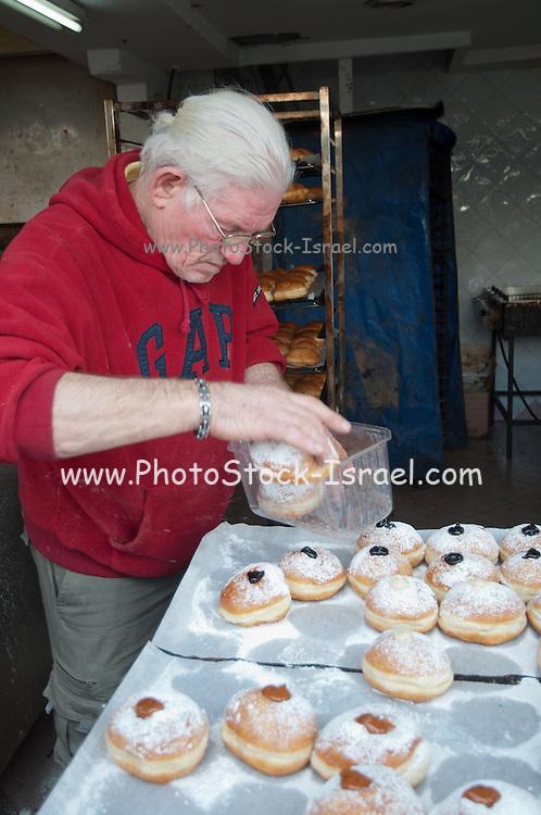 Israel, Jerusalem, Machane Yehuda market selling sofganyot (doughnuts)