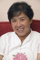 Older woman; smiling,