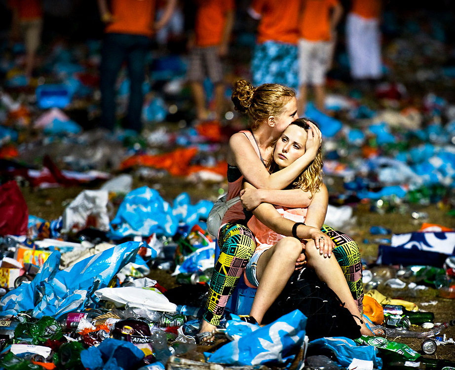 The Netherlands, Amsterdam, 11-07-2010.<br /> Two female supporters of the Dutch national football team sitting on the Museumplein in Amsterdam are mourning about the loss of the Dutch in the final of the World Cup in South-Africa against Spain. <br /> Photo : Klaas Jan van der Weij