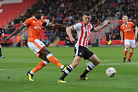 Blackpool's Joe Dodoo crosses the ball despite the attentions of Exeter City's Dara O'Shea<br /> <br /> Photographer Kevin Barnes/CameraSport<br /> <br /> Emirates FA Cup First Round - Exeter City v Blackpool - Saturday 10th November 2018 - St James Park - Exeter<br />  <br /> World Copyright © 2018 CameraSport. All rights reserved. 43 Linden Ave. Countesthorpe. Leicester. England. LE8 5PG - Tel: +44 (0) 116 277 4147 - admin@camerasport.com - www.camerasport.com