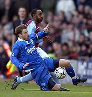 Photo: Richard Lane.<br /> Aston Villa v Birmingham City. Barclaycard Premiership. 22/02/2004.<br /> Kenny Cunningham goes down under pressure from Darius Vassell