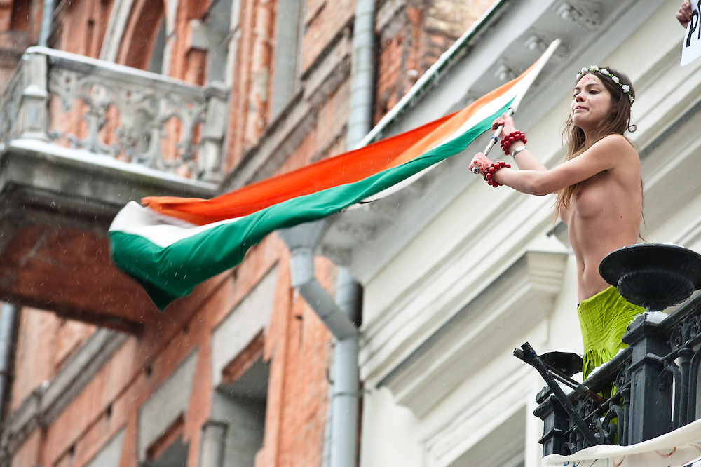 """Kiev, January 18, 2012: four FEMEN activists occupied the balcony residence of the Ambassador of India in Ukraine. Activists unfurled a banner on the balcony """"We're not prostitutes,"""" shouting """"Delhi, close their brothels,"""" """"The Ukrainians are not prostitutes!"""" and """"We demand an apology."""" The four activists were arrested and taken to the police station.<br /> <br /> The action was directed against the official policy of the Foreign Ministry of India, urging their ambassady in the CIS countries be scanned women aged 15 to 40 years, traveling to India. Thus, the official Delhi wants to insulate itself from the invasion of post-Soviet women, allegedly responsible for the rapid development of India's sex industry. Oksana Shachko"""