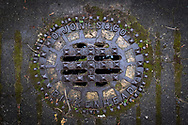 Maintenance Hole- and Drain Covers of Wirral by Colin McPherson, 2020-21.<br /> <br /> A maintenance hole (manhole) cover manufactured by O. Jones of Birkenhead, a company which supplied numerous covers in Wirral before local government reorganisation in the 1970s. The company no longer exists.