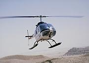 Oil industry in Dharhan desert area, Saudi Arabia, helicopter Bell 206 JetRanger 1979