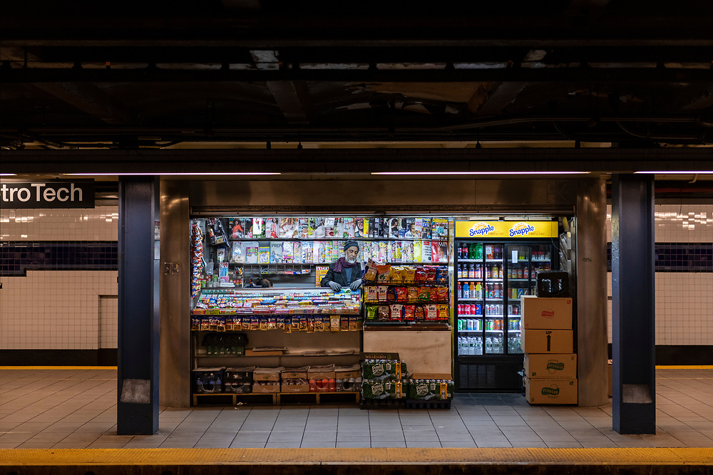 New York City, USA - March 20, 2020: Due to the coronavirus pandemic and state of emergency, business is slow at a platform kiosk at the normally bustling Jay Street–MetroTech subway station in Brooklyn.