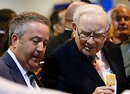 Berkshire Hathaway CEO Warren Buffett (R) talks with BNSF CEO Matt Rose before the Berkshire Hathaway annual meeting in Omaha, Nebraska, U.S. May 6, 2017. REUTERS/Rick Wilking