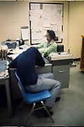 Juvenile intake counselors at the Atlanta Fulton County Juvenile Detention Center, Atlanta, GA.