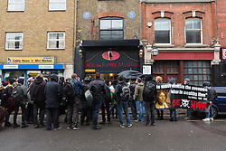 © Licensed to London News Pictures. 07/11/2015. London, UK. Class War and supporters stage a protest outside the Jack the Rippper Museum in Cable Street, Shadwell, east London. Protesters want to shut the museum down, accusing museum owner, Mark Palmer-Edgecumbe of glorifying rape and sexual violence against women. The original planning application for the museum submitted to Tower Hamlets council stated that it would celebrate the lives and history of east end women. This week a retrospective planning application for the museum sign and frontage was refused by the council.  Photo credit : Vickie Flores/LNP