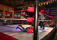 Karen Qu jumps Deonna Purrazza during Pro Wrestling Injustice for Brawl at the Whiskey Barrel Saturday night.  (Karen Bobotas/for the Laconia Daily Sun)
