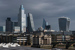 © Licensed to London News Pictures. 05/10/2020. LONDON, UK.  The skyscrapers in the City of London's financial district are bathed in sunshine after Storm Alex brought heavy rain to the UK over the weekend.   The forecast is for more changeable weather over the next few days.  Photo credit: Stephen Chung/LNP