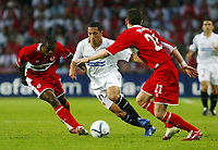 Photo: Chris Ratcliffe.<br /> Middlesbrough v Sevilla. UEFA Cup Final. 10/05/2006.<br /> Middlesbrough's Stuart Parnaby and George Boateng tussles with Sevilla's Luis Fabiano.