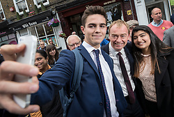 © Licensed to London News Pictures. 07/06/2017. Twickenham, UK. Liberal Democrat leader Tim Farron (C) poses for a selfie as he campaigns in Twickenham with local candidate Vince Cable on the last day of the election before the polls open. Photo credit: Peter Macdiarmid/LNP