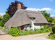 Pretty historic thatched cottage home in village of Whatfield, Suffolk, England, UK