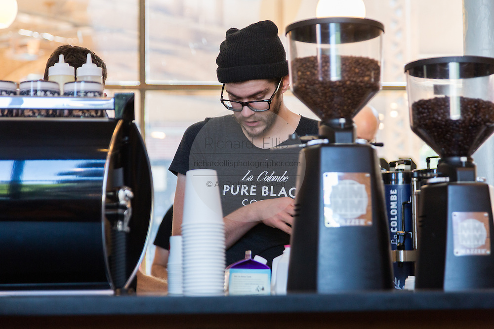 A barista creates espresso drinks at the trendy Pure Black coffee shop in the hip Wicker Park neighborhood in the West Town community in Chicago, Illinois, USA