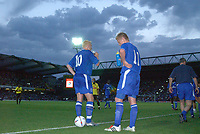 Damien Duff and Mikael Forssell (Chelsea) take drinks on board during a break in the game. Watford v Chelsea, Pre-Season Friendly, 5/08/2003. Credit: Colorsport / Matthew Impey DIGITAL FILE ONLY