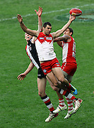 Heath Grundy of the Swans goes up for a mark during the AFL Round 22 match between the Sydney Swans and the St Kilda Saints at ANZ Stadium, Sydney.