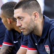 An injured Clint Dempsey watches from the bench prior to an international friendly soccer match between Scotland and the United States at EverBank Field on Saturday, May 26, 2012 in Jacksonville, Florida.  The United States won the match 5-1 in front of 44,000 fans. (AP Photo/Alex Menendez)