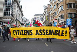 Extinction Rebellion activists join thousands of people attending a United Against The Tories national demonstration organised by the People's Assembly Against Austerity in protest against the policies of Prime Minister Boris Johnson's Conservative government on 26th June 2021 in London, United Kingdom. The demonstration contained blocs from organisations and groups including Palestine Solidarity Campaign, Stand Up To Racism, Stop The War Coalition, Extinction Rebellion, Kill The Bill and Black Lives Matter as well as from trade unions Unite and the CWU.