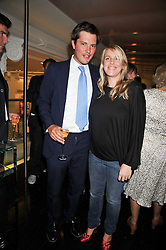 HARRY LOPES and his wife LAURA PARKER BOWLES at the launch of Tom Parker Bowles's new book 'Full English' held in the Gallery Restaurant, Selfridges, Oxford Street, London on 9th September 2009.