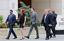 "Taylor Swift v David Mueller trial in Denver day five arrivals at court. Pictured Taylor Swift's brother, Austin, publicist Tree Paine and security detail leaving the Ritz-Carlton hotel to walk to the nearby courthouse. Also sign in a nearby office window that reads ""FEARLESS."". 11 Aug 2017 Pictured: Taylor Swift v David Mueller day five courthouse arrivals. Photo credit: Leigh Green/MEGA TheMegaAgency.com +1 888 505 6342"