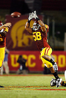 1 September 2007: MLB #58 Rey Maualuga jumps to block the ball during the USC Trojans college football team defeated the Idaho Vandals 38-10 at the Los Angeles Memorial Coliseum in CA.  NCAA Pac-10 #1 ranked team first game of the season.