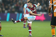 Aaron Cresswell of West Ham United taking a shot at goal. Premier league match, West Ham Utd v Hull city at the London Stadium, Queen Elizabeth Olympic Park in London on Saturday 17th December 2016.<br /> pic by John Patrick Fletcher, Andrew Orchard sports photography.