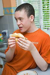 Teenage boy in the kitchen,