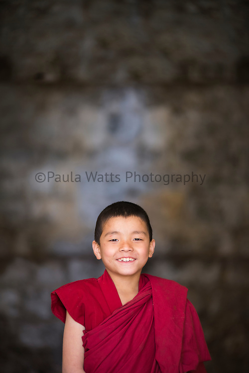 Young buddhist monk from Nepal in red robe
