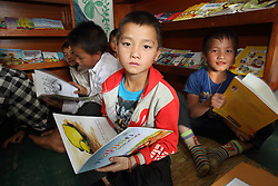 Children at the library in the primary school supported by THPC school in  Nongxong village