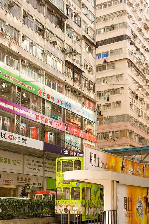 Causeway Bay, Hong Kong Island, Hong Kong, China - December 05, 2008: Traditional tram and store signs in a street view.