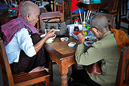Old Cambodian women eating a noodle soup in a restaurant of Phnom Penh, Cambodia, Southeast Asia