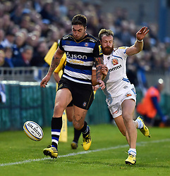 Matt Banahan of Bath Rugby puts in a grubber kick despite the challenge of James Short of Exeter Chiefs - Mandatory byline: Patrick Khachfe/JMP - 07966 386802 - 10/10/2015 - RUGBY UNION - The Recreation Ground - Bath, England - Bath Rugby v Exeter Chiefs - West Country Challenge Cup.