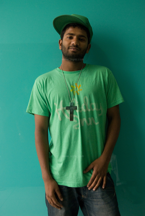 Sahil Malhotra (20) a Hindu youth wearing a cross as a decoration and style statement. West End mall, Ludhiana, Punjab