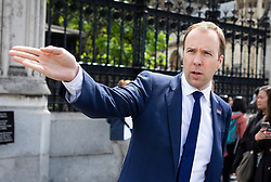 © Licensed to London News Pictures. 14/06/2019. London, UK. Health Secretary Matt Hancock gestures as he leaves Parliament after announcing that he is withdrawing from the Conservative Party leadership race after polling only 20 votes. Favourite Boris Johnson received 114 votes in the ballot to replace Theresa May . Photo credit: Rob Pinney/LNP
