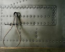 Measuring Calipers leaning against riveted metal
