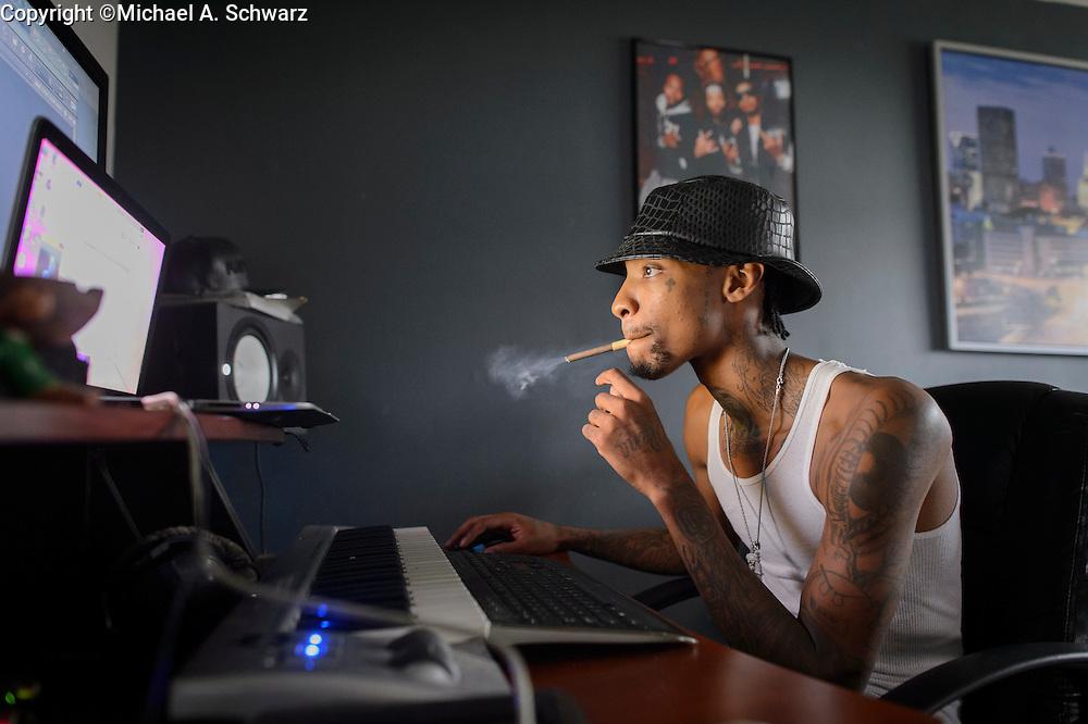 ATLANTA GA. August 14, 2014. Sonny Digital (Sonny Corey Uwaezuoke) creating music in his apartment/studio/office in Atlanta, GA. Photo by Michael A. Schwarz
