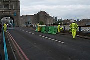 Tower Bridge closed and under refurbishment by workmen in London, England, United Kingdom. The famous bridge will be closed for 3 months while the roads are resurfaced and the boards are relaid on the moving parts of the bridge.