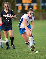 Gilford's Kelsey Buckley charges the ball down field during NHIAA Division III Field Hockey Friday afternoon.  (Karen Bobotas/for the Laconia Daily Sun)