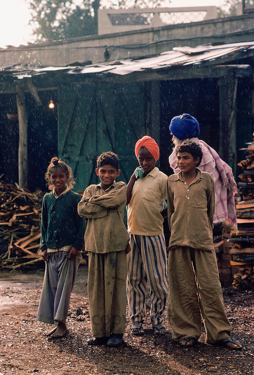 Indian children wearing traditional sikh turbans