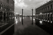 """Piazzetta San Marco at sunrise, with the Doge's Palace and the Marciana Libray. Taken on a early morning at the end of January, while the  rising tide was starting to flood the square, producing that phenomenon knows as """"acqua alta""""."""