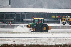© Licensed to London News Pictures. 27/02/2018. Leeds UK. The snow plough works to clear away snow from the runway this morning at Englands highest airport Leeds Bradford International in Yorkshire. Photo credit: Andrew McCaren/LNP