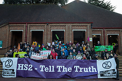 Uxbridge, UK. 1 February, 2020. Environmental activists from Stop HS2, Save the Colne Valley and Extinction Rebellion campaigning against the controversial HS2 high-speed rail link stand outside the London Borough of Hillingdon Civic Centre in Uxbridge during a 'Still Standing for the Trees' march from the Harvil Road wildlife protection camp in Harefield through Denham Country Park to three addresses closely linked to Boris Johnson in his Uxbridge constituency. The Prime Minister is expected to make a decision imminently as to whether to proceed with the high-speed rail line.