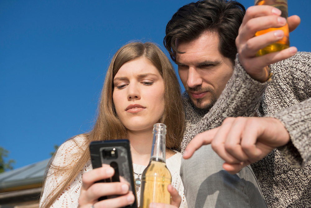 Young couple cell phone SMS bad news
