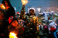 Eric Murphy, 13, left, Dayon Murray, 4, and Eriqua Lewis, 8, attend a candlelight vigil in memory of four sisters in southeast Washington on Thursday, Jan. 17, 2008. The four children of Banita Jacks, ages 5 to 16, were found dead in their home on Jan. 9, 2008, and their mother is accused of their murders. (photo by Jacquelyn Martin/AP Photo)