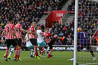 Football - 2016 / 2017 Premier League - Southampton vs. West Ham United<br /> <br /> Mark Noble of West Ham United free kick deflects of Southampton's James Ward-Prowse to flick past Southampton's Fraser Forster at St Mary's Stadium Southampton England<br /> <br /> COLORSPORT/SHAUN BOGGUST
