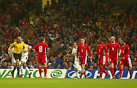 Photograph: Scott Heavey.<br />Euro 2004 Group 9 Qualifying match.<br />Wales v Serbia and Montenegro. 11/10/2003.<br />The Welsh team stand stunned after Serbia take an early lead.