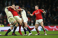Josh Adams of Wales is stopped by Joe Launchbury and Jonny May ® of England.  England v Wales, NatWest 6 nations 2018 championship match at Twickenham Stadium in Middlesex, England on Saturday 10th February 2018.<br /> pic by Andrew Orchard, Andrew Orchard sports photography