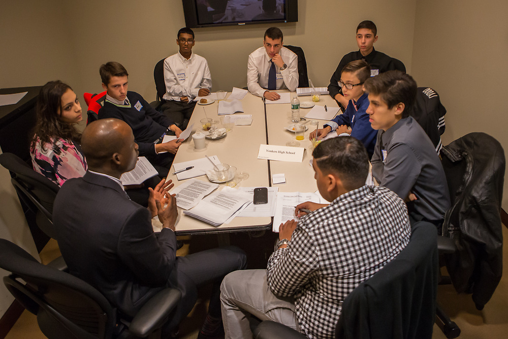 Purchase, NY – 31 October 2014. The team from Yonkers High School analyzing their brief with Morgan Stanley facilitator Keron Edwards. The Business Skills Olympics was founded by the African American Men of Westchester, is sponsored and facilitated by Morgan Stanley, and is open to high school teams in Westchester County.